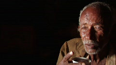 Ethiopia: Elderly poor man sips coffee - stock footage