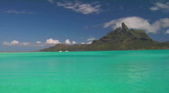 Stock Video Footage of Bora bora's mountainous peak in the background with crystal turquoise waters in