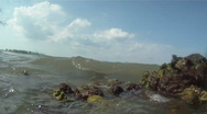 Stock Video Footage of Ocean Waves Break & Splash Against Rocks On The Beach