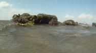 Ocean Waves Break & Splash Against Rocks On The Beach Stock Footage