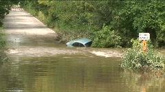 Blue car flood zoomin Stock Footage