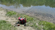 Two fishing poles on a quite lake Stock Footage