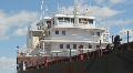 Cargo ship at dock. Closeup. Timelapse. Footage