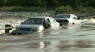 Stock Video Footage of two cars flood tight
