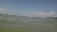 In The Waters Off Fort DeSoto Beach / Jetski and Fishermen In Distance - stock footage