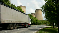 Road traffic passing the cooling towers of a coal fired power station. Yorkshire Stock Footage