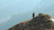 Stock Video Footage of hunter morning on a mountain ridge