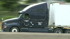 Trailer drives by 3 Stock Footage