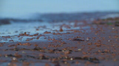 Red pebbles and waves 1 - stock footage
