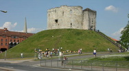 Stock Video Footage of Standing high above the city of York is Clifford's Tower. Yorkshire England UK