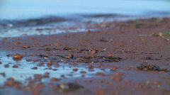 Red pebbles and waves 2 Stock Footage