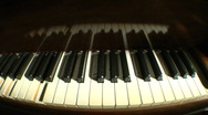 Stock Video Footage of Piano keys dolly fish above