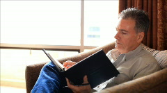 Man writing notes 1 Stock Footage