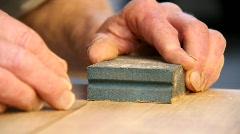 Man hand sanding Stock Footage