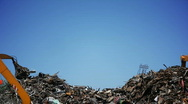 Scrapyard with claw Stock Footage