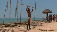 Mayan warrior on beach Stock Footage