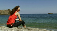 Woman on resting on the shore Stock Footage
