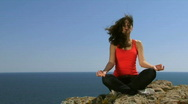 Woman sitting on a rock Stock Footage