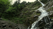 Stock Video Footage of Long Waterfall Down a Mountain