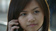 Stock Video Footage of HD1080 Young asian woman talking on cell phone outdoor. Portrait.