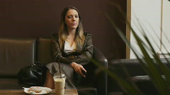 HD1080p Young sexy blond woman at a cafe Stock Footage