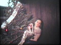 Putting Garland On The Christmas Tree (1980 Vintage 8mm film) Stock Footage