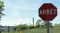 French Stop Sign with Factory Smoke Stacks in back ground Stock Footage