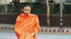 One Monk Walking Stock Footage
