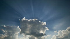 Sunburst from cloud timelapse Stock Footage