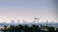 Take-off of a jet plane - Over Urban View Stock Footage