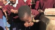 Stock Video Footage of Students get a drink from a tap at their school