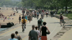 Crowded lakefront path Stock Footage