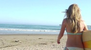 Stock Video Footage of Summer - Attractive Young Woman Heads to Ocean with Surfboard