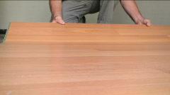Man Installs Flooring Stock Footage