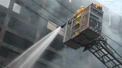 BRAVE Firefighters Hose FIREMEN BLAZE Fire Burning Building Emergency BATTLE Stock Footage