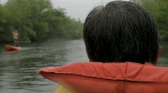 Man rowing a canoe - stock footage