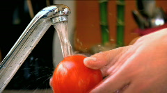Washing a Red Tomato Stock Footage