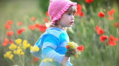 Child in a field of poppies near the laughs-2 - stock footage