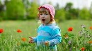 Child in a field of poppies near the laughs-2 Stock Footage