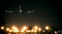 Perfect Landing of a jet plane - night time 2 - stock footage