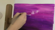 Hand of a young woman painting in purple  Stock Footage