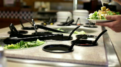 Putting dressing on Salad - stock footage