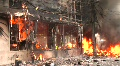 BURNING STOREFRONT Explosion Urban Unrest Violence Terror Attack Bomb Syria  Footage