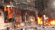 BURNING STOREFRONT Explosion Urban Unrest Violence Terror Attack Bomb Syria  Stock Footage