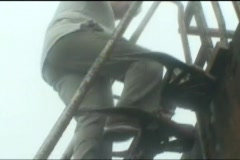 Going down oil rig ladder in bad weather and fog Stock Footage