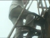 Stock Video Footage of Going down oil rig ladder in bad weather and fog