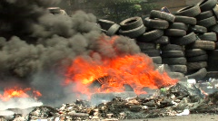 Burning Barricade of Tires BURNING Smoke Fire Terror  Riot Conflict Civil War - stock footage
