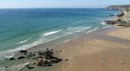 Gentle waves reach the sandy beach at Porthtowan. Stock Footage