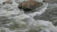 Rock in rushing river. Stock Footage