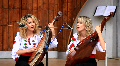 Beautiful twin sisters playing banduras (Ukrainian string instrument) HD Footage